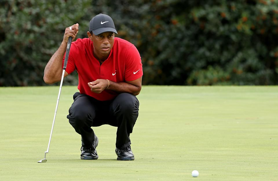 AUGUSTA, GEORGIA - NOVEMBER 15: Tiger Woods of the United States lines up a putt on the 14th green during the final round of the Masters at Augusta National Golf Club on November 15, 2020 in Augusta, Georgia. (Photo by Jamie Squire/Getty Images)
