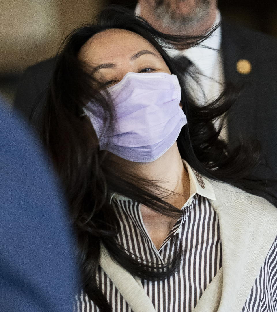 Meng Wanzhou leaves B.C. Supreme Court in Vancouver, British Columbia, Monday, Sept. 28, 2020. The senior executive for Chinese communications giant Huawei Technologies was in court arguing that her extradition to the U.S. should be halted because her rights have been violated. (Jonathan Hayward/The Canadian Press via AP)