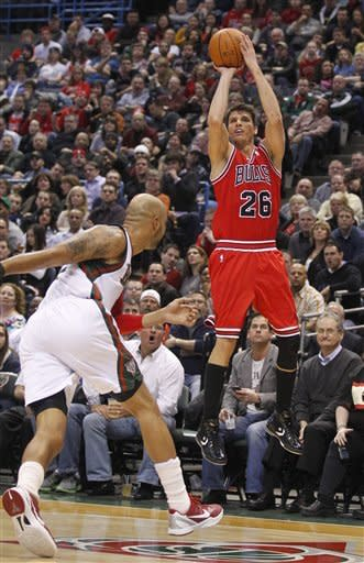 Chicago Bulls' Kyle Korver (26) puts up a three-point shot against Milwaukee Bucks' Drew Gooden, left, during the first half of an NBA basketball game on Saturday, Feb. 4, 2012, in Milwaukee. (AP Photo/Jeffrey Phelps)