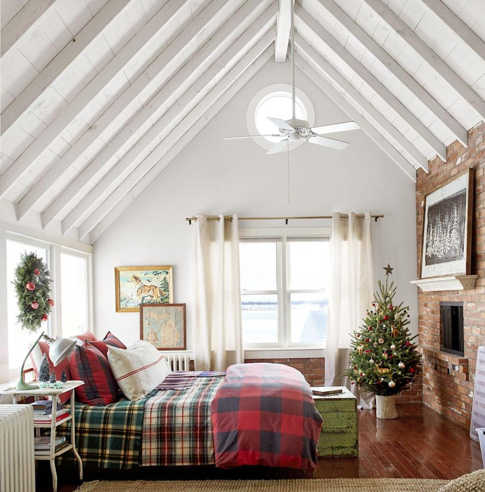 """<p>These <a href=""""https://www.countryliving.com/home-design/house-tours/g4929/farmhouse-packed-christmas-decorating-ideas/"""" rel=""""nofollow noopener"""" target=""""_blank"""" data-ylk=""""slk:Midwest farmhouse owners"""" class=""""link rapid-noclick-resp"""">Midwest farmhouse owners</a> gave their bedroom some festive flair around the holidays with a mini tree outfitted with ornaments that accent their decor.</p><p><strong><a class=""""link rapid-noclick-resp"""" href=""""https://go.redirectingat.com?id=74968X1596630&url=https%3A%2F%2Fwww.wayfair.com%2Fbed-bath%2Fpdp%2Feddie-bauer-edgewood-plaid-blanket-erb1279.html&sref=https%3A%2F%2Fwww.countryliving.com%2Fhome-design%2Fdecorating-ideas%2Fadvice%2Fg1247%2Fholiday-decorating-1208%2F"""" rel=""""nofollow noopener"""" target=""""_blank"""" data-ylk=""""slk:SHOP PLAID BLANKETS"""">SHOP PLAID BLANKETS</a></strong></p>"""