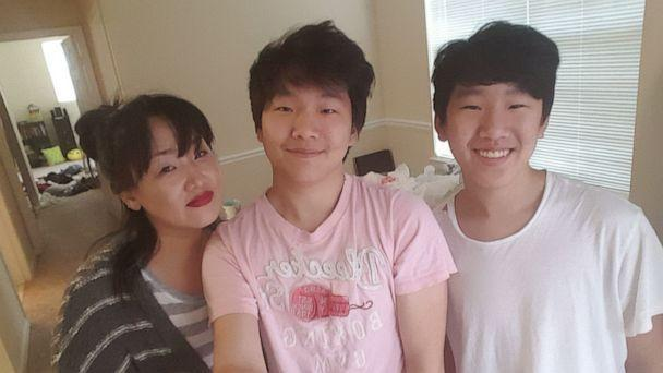 PHOTO: Atlanta spa shooting victim Hyun Jung Grant is seen (L) with her sons. (Randy Park)