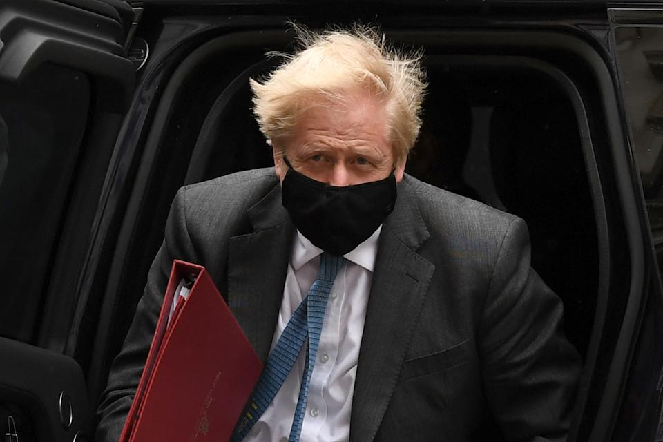 Britain's Prime Minister Boris Johnson wearing a face covering due to Covid-19, arrives back at 10 Downing Street in central London on April 28, 2021. - Britain's Electoral Commission on Wednesday announced a formal probe into how Prime Minister Boris Johnson paid for a lavish makeover of his Downing Street flat, seriously escalating a simmering scandal. (Photo by DANIEL LEAL-OLIVAS / AFP) (Photo by DANIEL LEAL-OLIVAS/AFP via Getty Images)