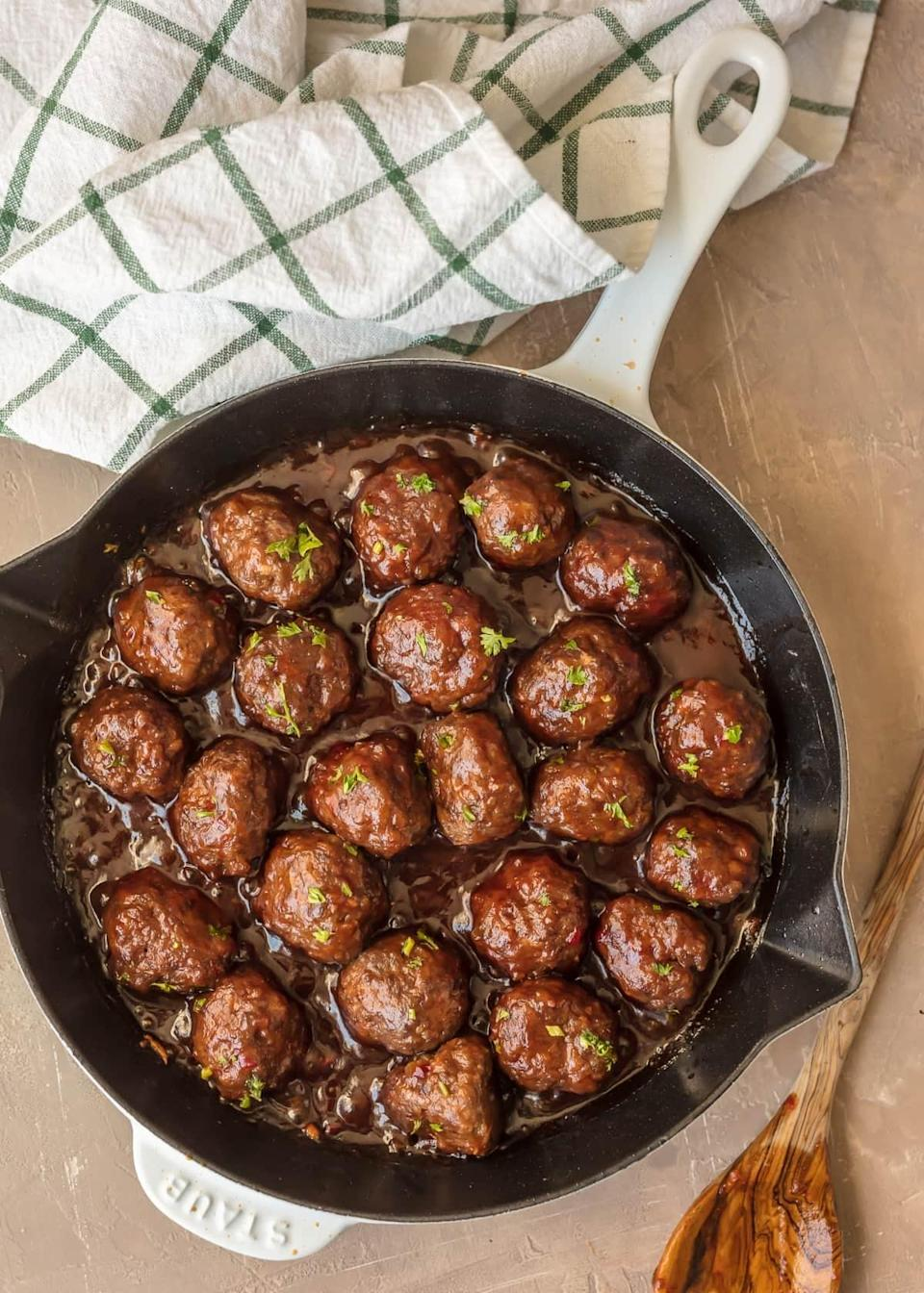 """<p>Cooked in a cranberry pepper jelly sauce, these flavorful meatballs are a perfect harmony of all the best flavors.</p> <p><strong>Get the recipe:</strong> <a href=""""https://www.thecookierookie.com/cranberry-cocktail-meatballs/"""" class=""""link rapid-noclick-resp"""" rel=""""nofollow noopener"""" target=""""_blank"""" data-ylk=""""slk:sweet and spicy cranberry cocktail meatballs"""">sweet and spicy cranberry cocktail meatballs</a></p>"""