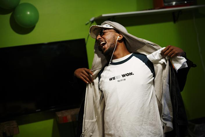 """<p>A customer displays a shirt reading """"Weed Won"""" on cannabis legalization day at the Hotbox Lounge and Shop in Toronto, Ontario, Canada, on Wednesday, Oct. 17, 2018. (Photo: Cole Burston/Bloomberg via Getty Images) </p>"""