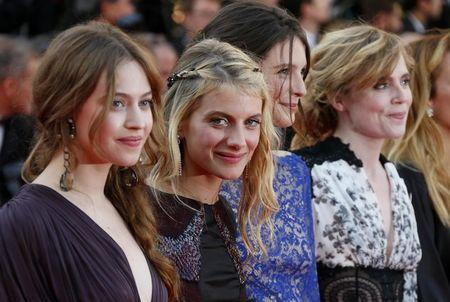 "Actresses Lou de Laage, Melanie Laurent, Josephine Japy, and Isabelle Carre pose on the red carpet as they arrive for the screening of the film ""The Homesman"" in competition at the 67th Cannes Film Festival in Cannes"