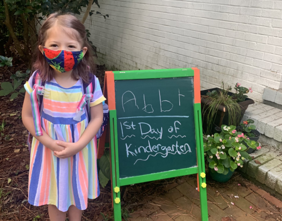 A kindergartener gets ready for her first day of school where masks are mandatory. (Photo: Twitter)