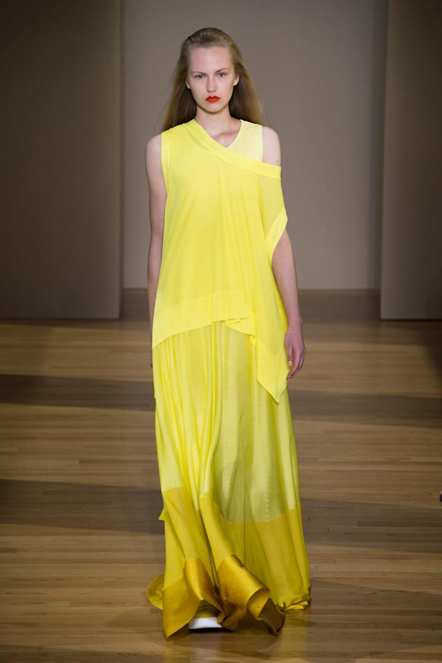 <p><i>Model wears a yellow maxi dress from the SS18 Agnona collection. (Photo: ImaxTree) </i></p>