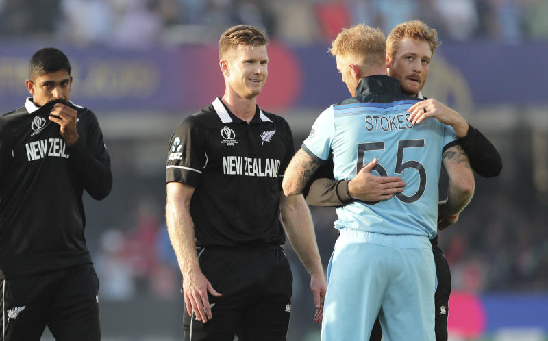 New Zealand's cricketers congratulate England's Ben Stokes after England won the Cricket World Cup final match between England and New Zealand at Lord's cricket ground in London, England, Sunday, July 14, 2019. (AP Photo/Aijaz Rahi)