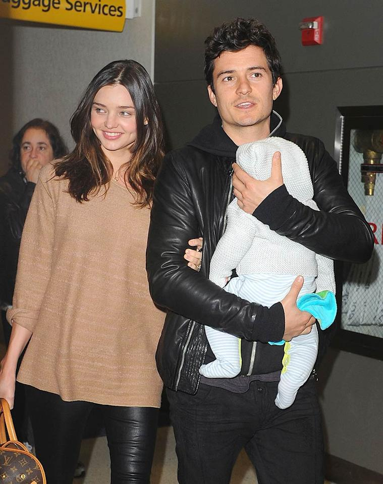 """Orlando, a newly outfitted Flynn, and his gorgeous mom, Victoria's Secret model Miranda Kerr, were spotted arriving at JFK airport in New York just a few hours later looking refreshed and happy. <a href=""""http://www.splashnewsonline.com"""" target=""""new"""">Splash News</a> - April 18, 2011"""