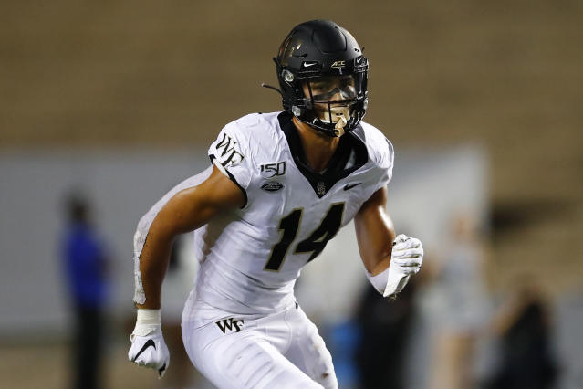 FILE - In this Sept. 6, 2019, file photo, Wake Forest wide receiver Sage Surratt (14) runs a pass route during an NCAA football game in Houston. The North Carolina-Wake Forest game will put brothers Sage and Chazz Surratt on opposite sides for the first time. Sage is a top receiver for the Demon Deacons, while Chazz has moved from quarterback to linebacker for the Tar Heels -- raising the odds that the two meet in a collision at some point Friday night. (AP Photo/Matt Patterson, File)