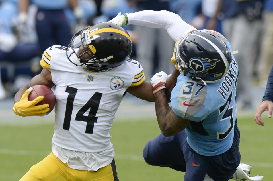 Tennessee Titans safety Amani Hooker (37) tries to bring down Pittsburgh Steelers wide receiver Ray-Ray McCloud (14) in the first half of an NFL football game Sunday, Oct. 25, 2020, in Nashville, Tenn. (AP Photo/Mark Zaleski)