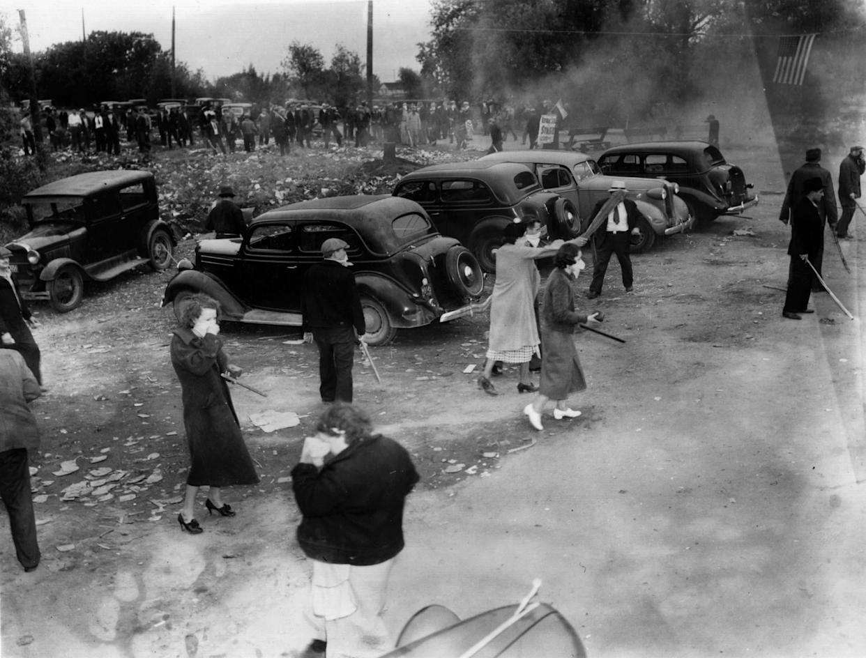 American police use tear gas against women pickets at the Newton Steel Company, Monroe, Michigan on June 10, 1937.