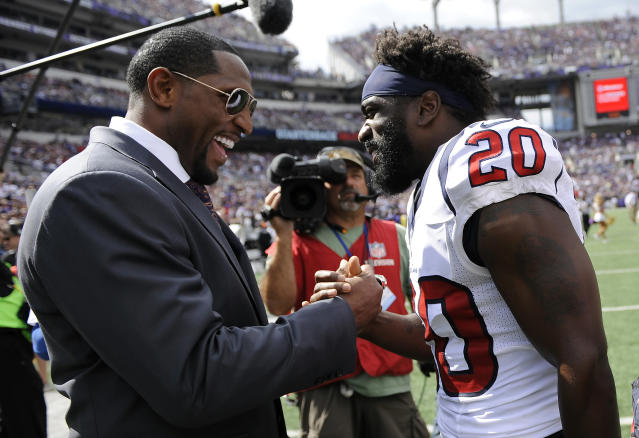 Former Baltimore Ravens linebacker Ray Lewis, left, and Houston Texans free safety Ed Reed chat during halftime of an NFL football game between the Ravens and the Texans Sunday, Sept. 22, 2013, in Baltimore. (AP Photo/Nick Wass)