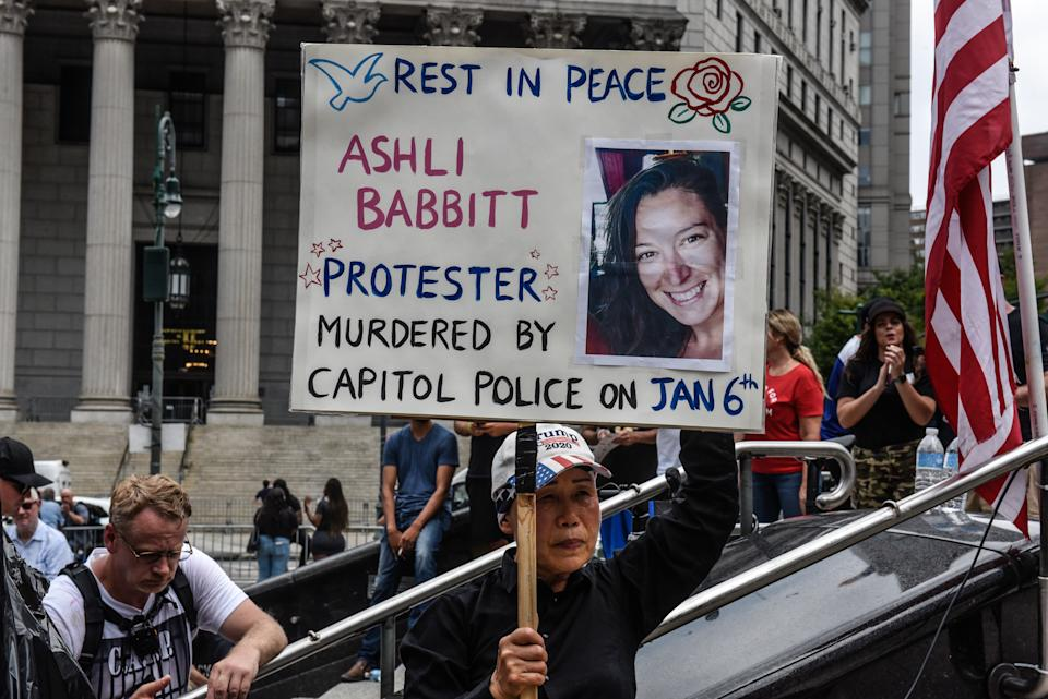A demonstrator holds a sign protesting Ashli Babbitt's death at the U.S. Capitol at a rally on July 25 in New York City. (