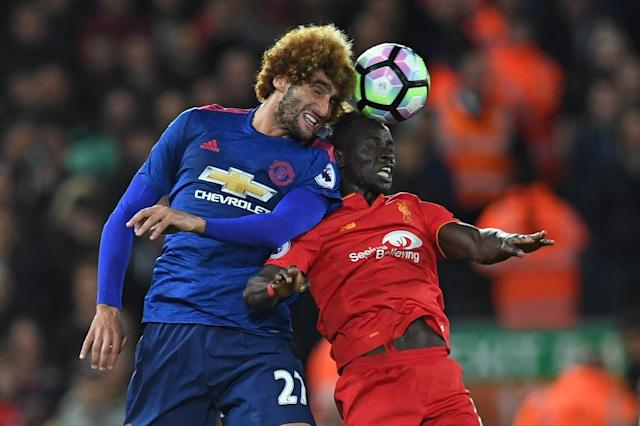 Manchester United's Marouane Fellaini (left) battles with Liverpool's Sadio Mane at Anfield on October 17, 2016 (AFP Photo/Paul Ellis)