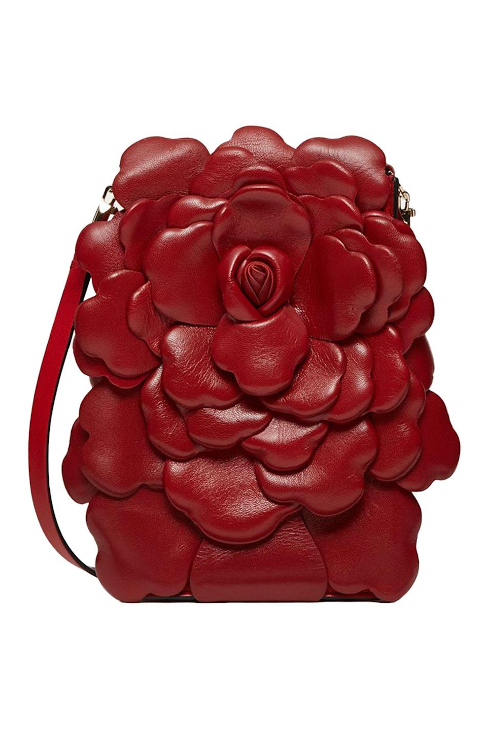 """<p><strong>THE SELECTION FOR HIM</strong></p><p>valentino.com</p><p><strong>$1750.00</strong></p><p><a href=""""https://www.valentino.com/en-us/cross-body-bags_cod22527730565966584.html#dept=US_Bags_W"""" rel=""""nofollow noopener"""" target=""""_blank"""" data-ylk=""""slk:Shop Now"""" class=""""link rapid-noclick-resp"""">Shop Now</a></p>"""