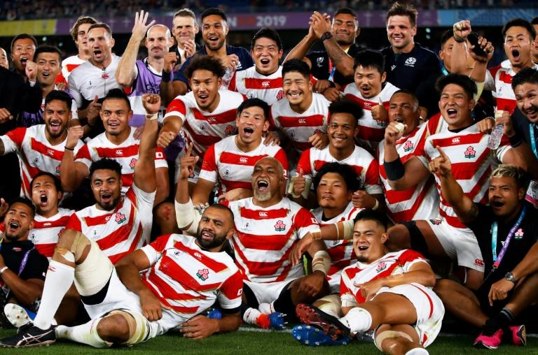 Day to remember: Japan's players celebrate beating Scotland