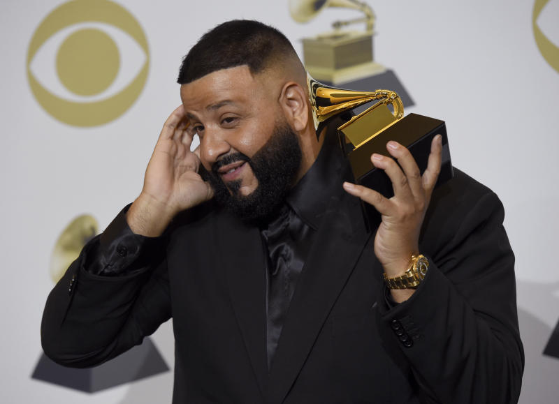"""DJ Khaled poses in the press room with the award for best rap/sung performance for """"Higher""""at the 62nd annual Grammy Awards at the Staples Center on Sunday, Jan. 26, 2020, in Los Angeles. (AP Photo/Chris Pizzello)"""
