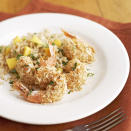 """<p>This island-inspired dinner features coconut-crusted shrimp alongside a fresh mango and herb-infused rice pilaf. Using packaged cooked brown rice is the secret to keeping the prep time short for this easy rice pilaf recipe. <a href=""""http://www.eatingwell.com/recipe/264766/coconut-shrimp-with-mango-rice-pilaf/"""" rel=""""nofollow noopener"""" target=""""_blank"""" data-ylk=""""slk:View recipe"""" class=""""link rapid-noclick-resp""""> View recipe </a></p>"""