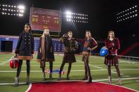 Models pose before presenting the Tommy Hilfiger Fall/Winter 2015 collection at the New York Fashion Week February 16, 2015. Shunning the traditional catwalk, Mr. Hilfiger instead presented his collection on a mock American Football field. REUTERS/Andrew Kelly (UNITED STATES - Tags: FASHION)