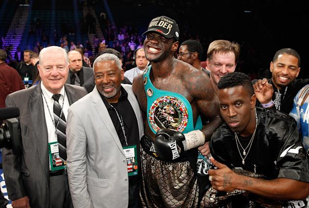 LAS VEGAS, NV - JANUARY 17: Deontay Wilder poses with members of his camp after defeating WBC heavyweight champion Bermane Stiverne at the MGM Grand Garden Arena on January 17, 2015 in Las Vegas, Nevada. Wilder took the title by unanimous decision. (Photo by Steve Marcus/Getty Images)