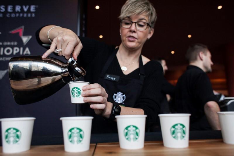 Sandy Roberts pours samples of Starbucks Reserve Sun Dried Ethiopia Yirgacheffe coffee during the company's annual shareholders meeting in Seattle