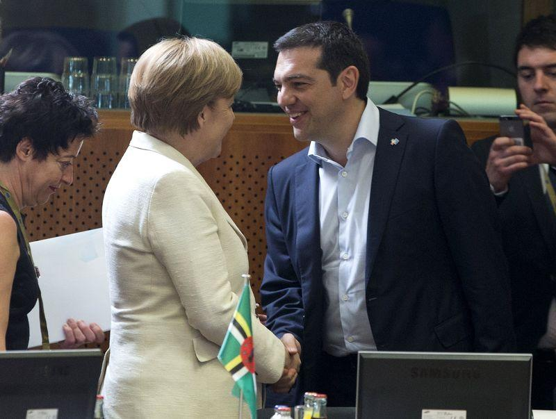 German Chancellor Angela Merkel shakes hands with Greek Prime Minister Alexis Tsipras at the start of an EU-CELAC Latin America summit in Brussels