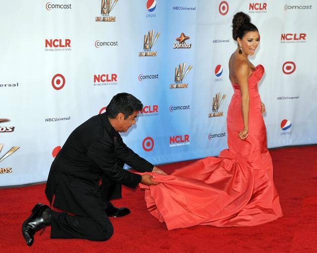 Actress Eva Longoria called upon the services of George Lopez to ensure she was looking her best on the red carpet. Next time, Eva, don't buy a dress with such a high-maintenance train.