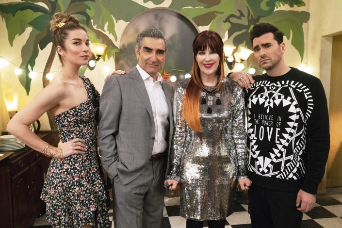 """This image released by Pop TV shows, from left, Annie Murphy, Eugene Levy, Catherine O'Hara and Dan Levy from the series """"Schitt's Creek."""" The series won the award for best television series, musical or comedy at the Golden Globe Awards on Sunday, Feb. 28, 2021. (Pop TV via AP)"""