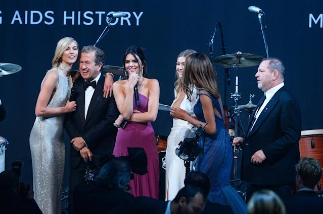Karlie Kloss, Kendall Jenner, Mario Testino, Gigi Hadid, Jordan Dunn and Harvey Weinstein onstage during amfAR's 22nd Cinema Against AIDS Gala in 2015 (Getty Images)