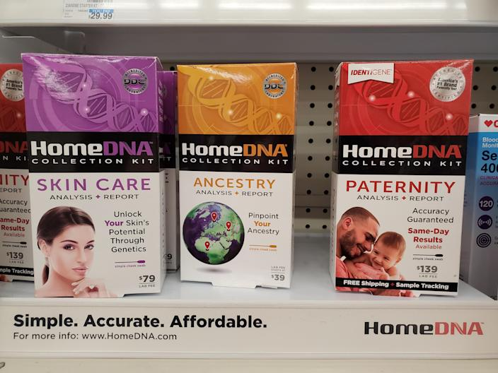 Closeup of HomeDNA kits, including testing for ancestry, skin care and paternity, on a pharmacy shelf. (Smith Collection/Gado/Getty Images)