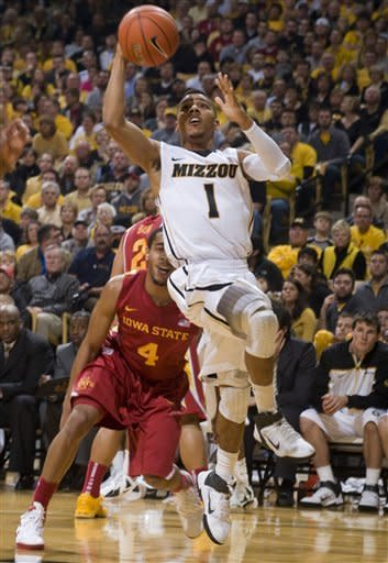 Missouri's Phil Pressey (1) shoots past Iowa State's Chris Allen (4) during the second half of an NCAA college basketball game Wednesday, Feb. 29, 2012, in Columbia, Mo. Missouri won the game 78-72. (AP Photo/L.G. Patterson)