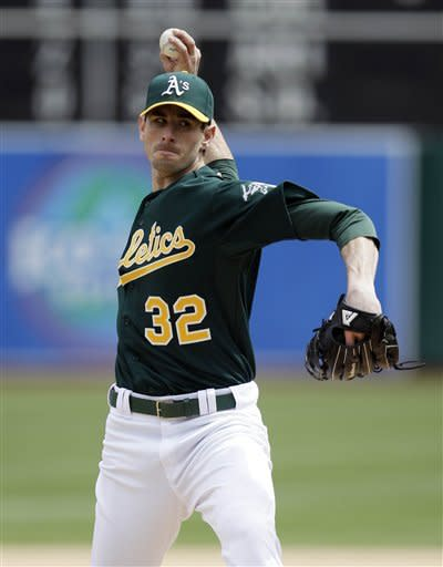 Oakland Athletics starting pitcher Brandon McCarthy throws to the Kansas City Royals during the first inning of a baseball game on Wednesday, April 11, 2012, in Oakland, Calif. (AP Photo/Marcio Jose Sanchez)