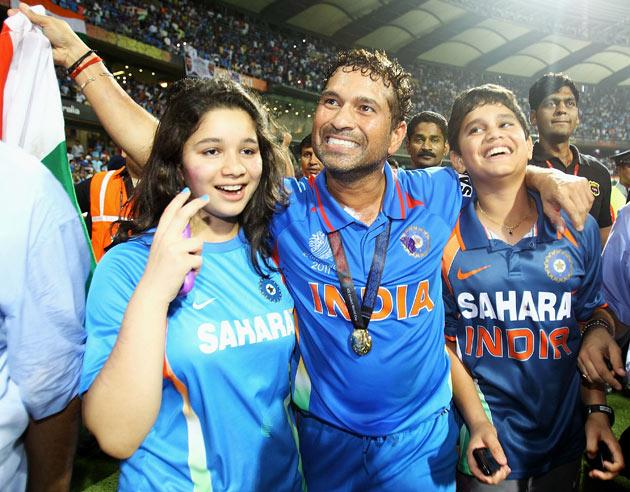 Sachin Tendulkar of India celebrates his teams win with his daughter Sara and son Arjun during the 2011 ICC World Cup Final between India and Sri Lanka at the Wankhede Stadium on April 2, 2011 in Mumbai, India.  (Photo by Matthew Lewis/Getty Images)