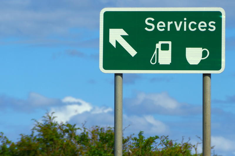 A motorway sign indicating an exit for the services. Photo: Getty
