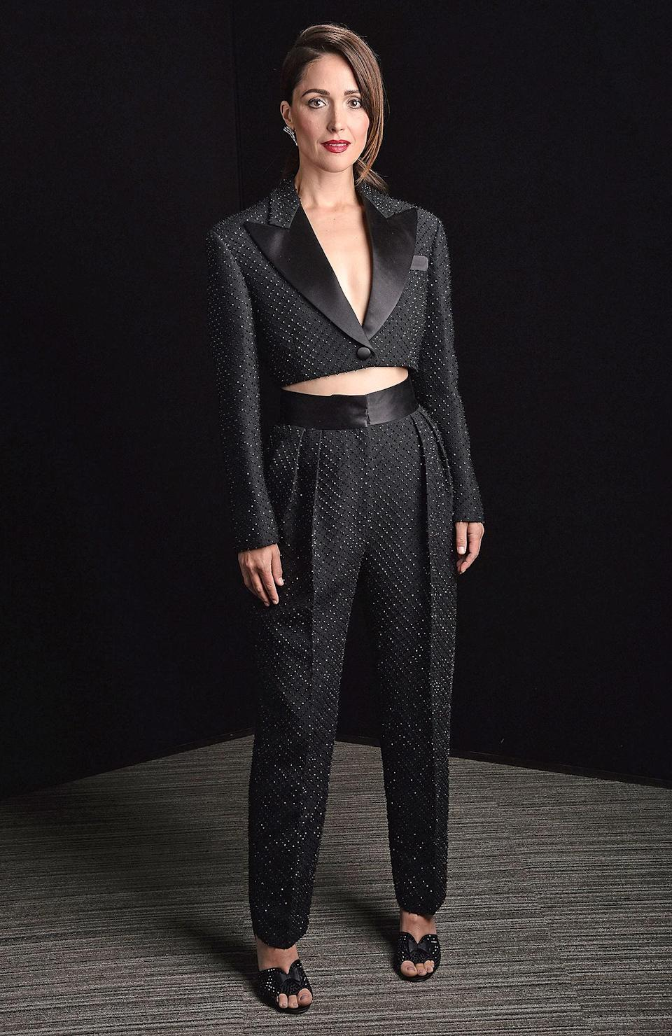 <p>in a shimmery Miu Miu suit. </p>