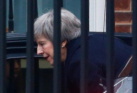Britain's Prime Minister Theresa May returns to Downing Street in London