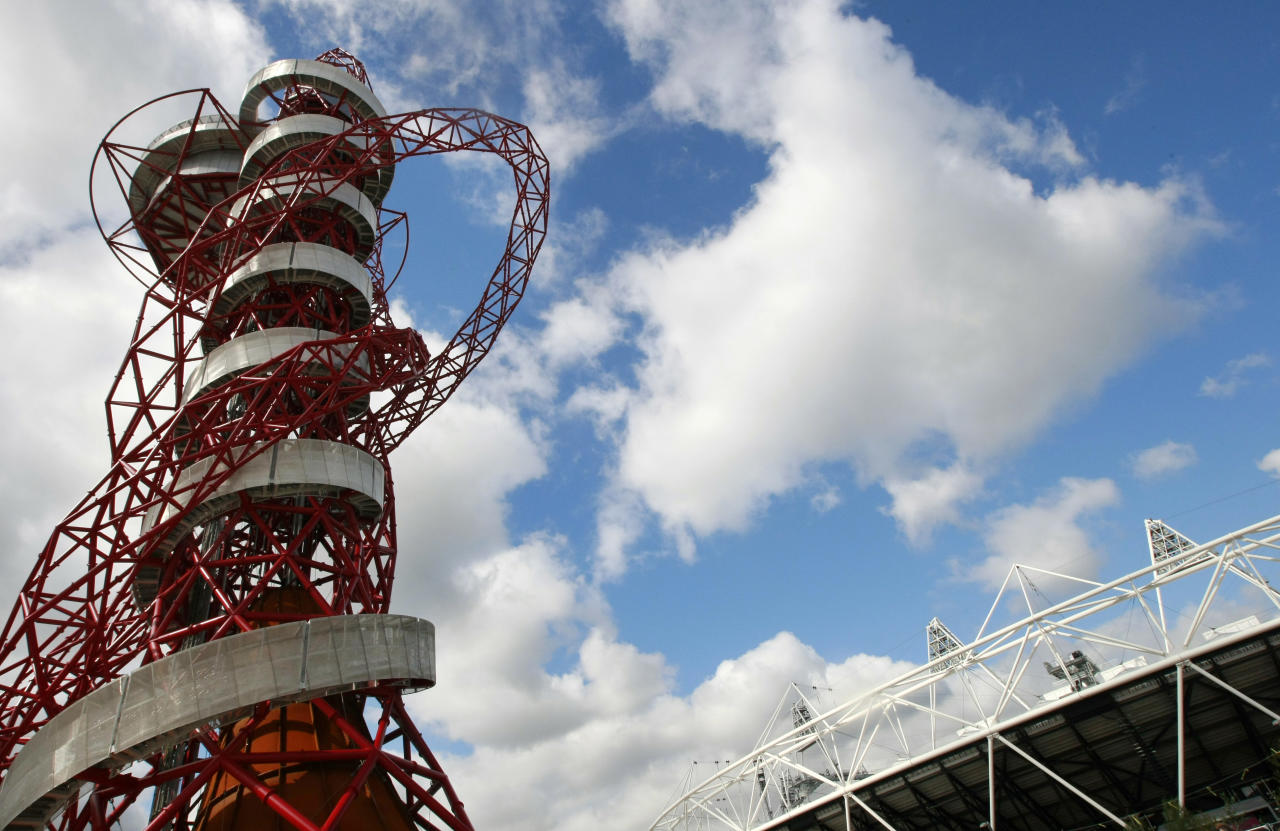 The ArcelorMittal Orbit sculpture, left, before its official unveiling at the Olympic Park, London, Friday May 11, 2012. The steel sculpture designed by Anish Kapoor and Cecil Balmond stands 114.5 meters (376ft) high, 63% of of the sculpture is recycled steel and incorporates the five Olympic rings. (AP Photo/Tim Hales)