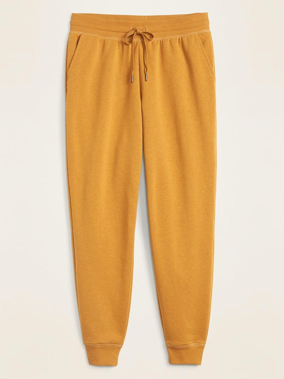 <p>Be bold and get these yellow <span>Old Navy Mid-Rise Tapered-Leg Jogger Pants</span> ($30).</p>