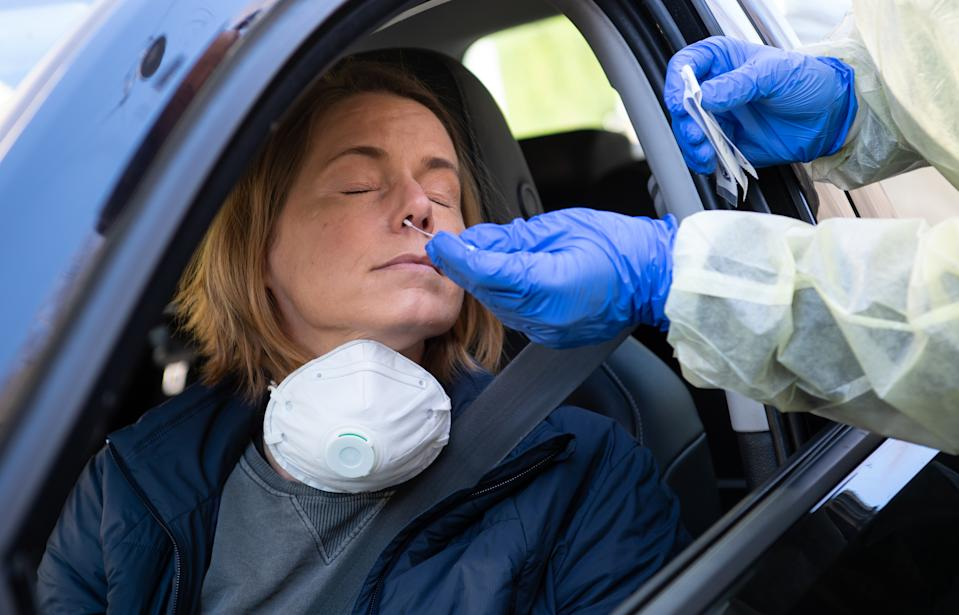 23 March 2020, Bavaria, Munich: Medical personnel demonstrate the taking of a nasal swab in a new test station in front of the Tropical Institute for people with suspected Covid-19. Only medical personnel and specific professional groups such as the police or fire brigade are to be tested at the new test station. Photo: Sven Hoppe/dpa (Photo by Sven Hoppe/picture alliance via Getty Images)