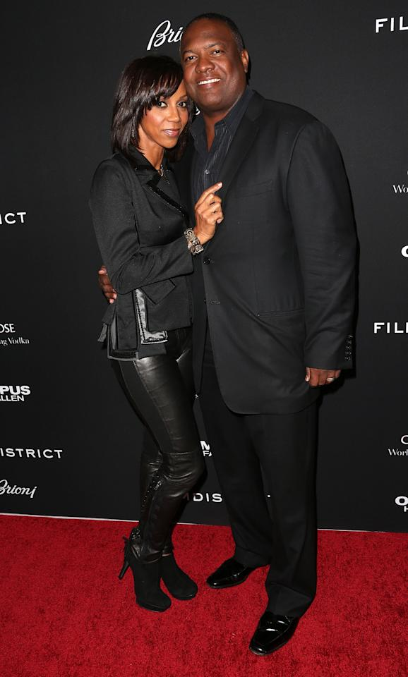 "HOLLYWOOD, CA - MARCH 18: Actress Holly Robinson Peete (L) and Rodney Peete attend the Premiere of FilmDistrict's ""Olympus Has Fallen"" at the ArcLight Cinemas Cinerama Dome on March 18, 2013 in Hollywood, California.  (Photo by Frederick M. Brown/Getty Images)"
