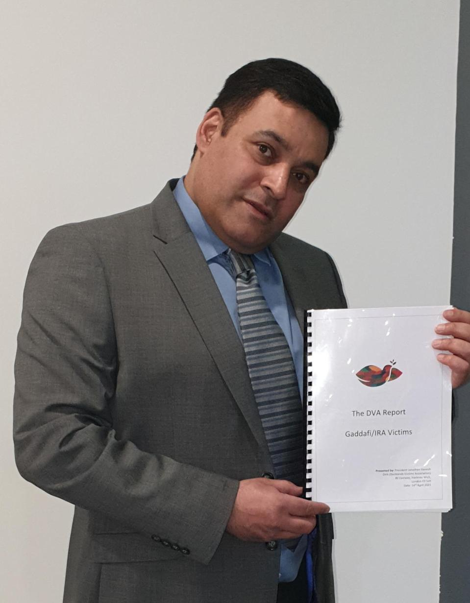 Jonathan Ganesh with his group's report on the Libyan compensation issue (DVA/PA)