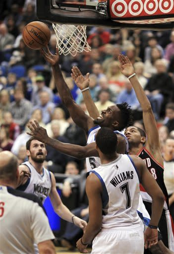 Portland Trail Blazers' Nicolas Batum (88) fouls Minnesota Timberwolves' Martell Webster (5) during the second quarter of an NBA basketball game, Wednesday, March 7, 2012, in Minneapolis. (AP Photo/The Star Tribune, Jeff Wheeler) MANDATORY CREDIT; ST. PAUL PIONEER PRESS OUT; MAGS OUT; TWIN CITIES TV OUT