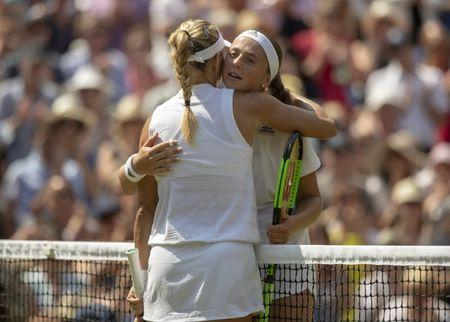 Jul 12, 2018; London, United Kingdom; Angelique Kerber (GER) at the net with Jelena Ostapenko (LAT) after their match on day 10 at All England Lawn and Croquet Club. Mandatory Credit: Susan Mullane-USA TODAY Sports