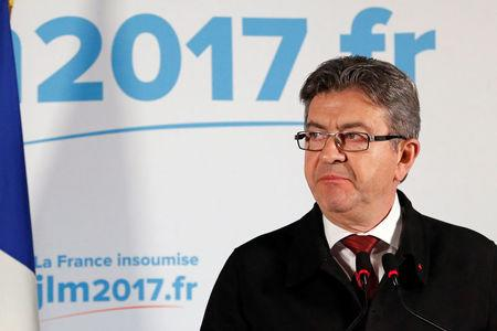 Jean-Luc Melenchon, candidate of the French far-left Parti de Gauche and candidate for the French 2017 presidential election, leaves after speaking to supporters after the first round of 2017 French presidential election in Paris
