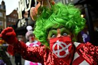 Britain's traditional pantomime dames, male actors in garish female costumes, took part in a protest march to the Houses of Parliament in London in September to highlight the impact the pandemic is having on live theatre
