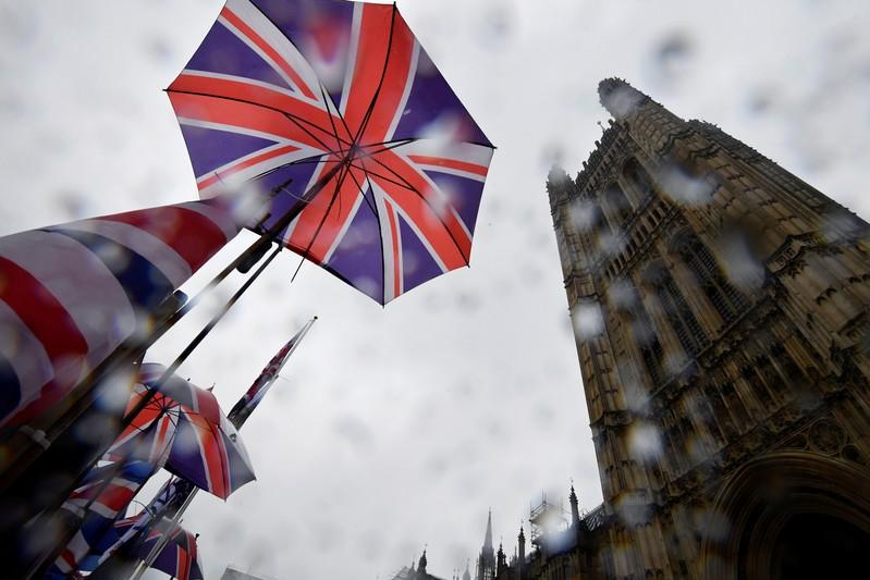 FILE PHOTO: Union Jack flags are seen outside the Houses of Parliament in London