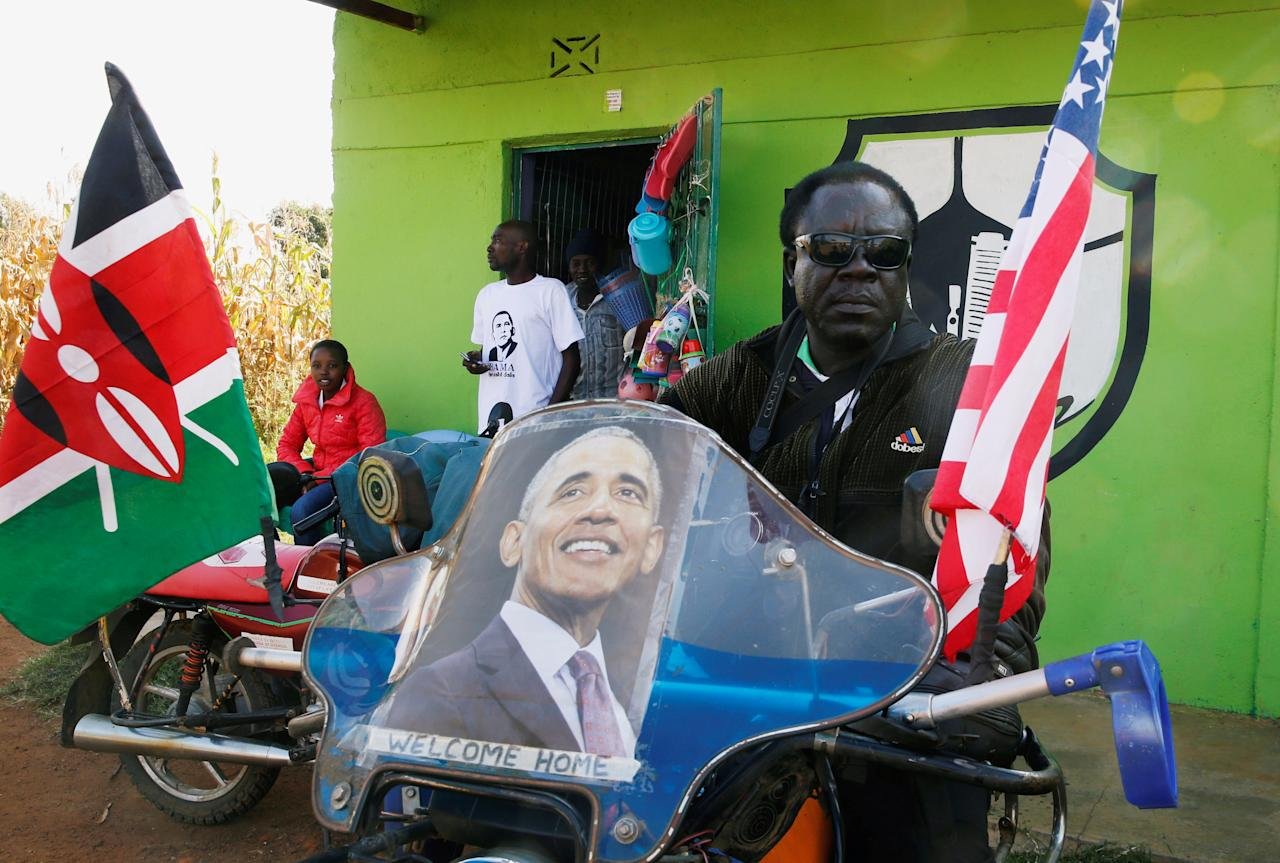 <p>A resident seats on his motorbike ahead of the visit by the former U.S. President Barack Obama to his ancestral Nyangoma Kogelo village in Siaya county, western Kenya July 16, 2018. (Photo: Thomas Mukoya/Reuters) </p>