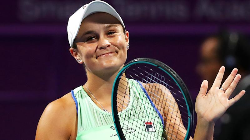 Ash Barty is pictured smiling after winning a match at the Qatar Open in 2020.