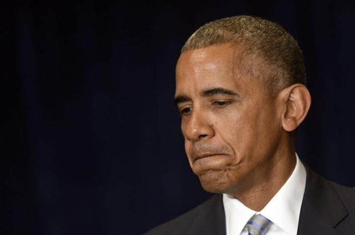 President Obama pauses as he makes a statement on the fatal police shootings of two black men in Louisiana and Minnesota after arriving in Warsaw, Poland, on Friday. (Photo: Susan Walsh/AP)
